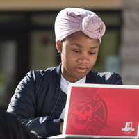 woman at laptop outside