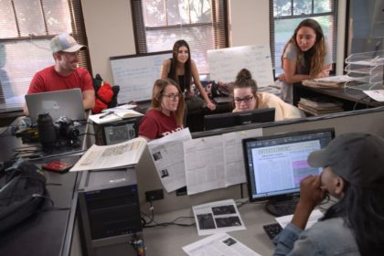 students gathered around computers