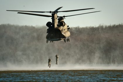 soldiers jumping out of helicopter