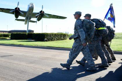 military members walking towards plane
