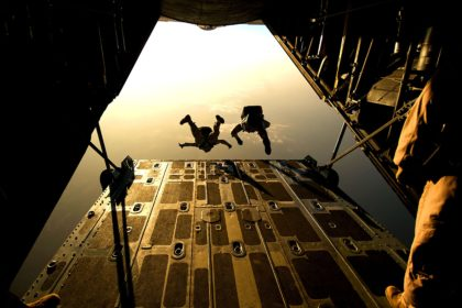 people jumping out of plane