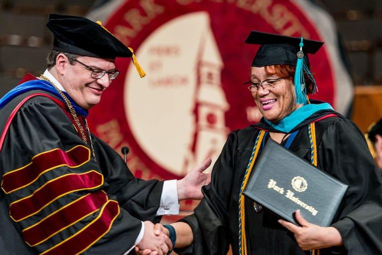 graduate getting diploma