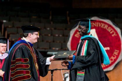 student getting diploma