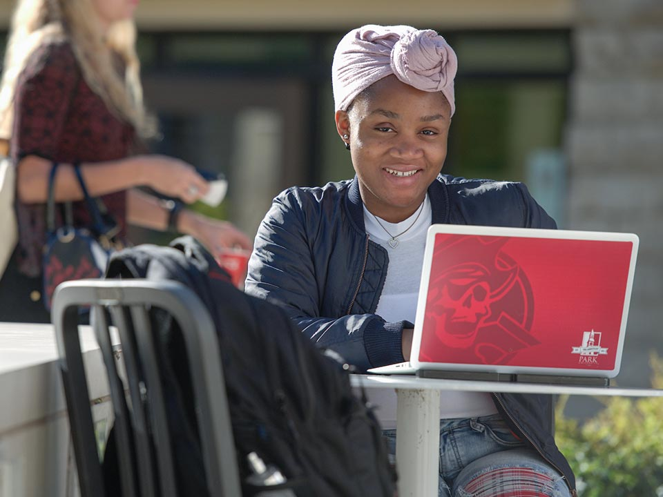 female student with laptop