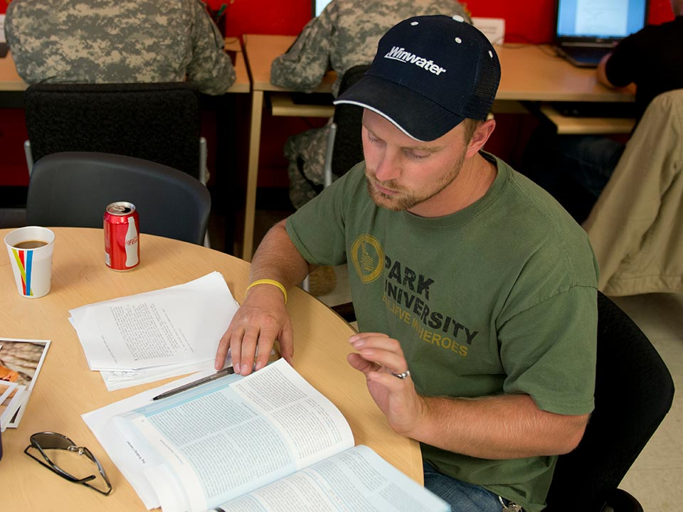 closeup of student at table with book