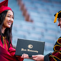Student receiving her diploma